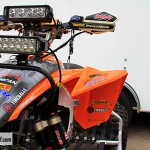 The PowerMadd hand guards cover up our Works Connection Pro Perch and our knuckles from the flying rocks that get kicked up on the front high speed straight.